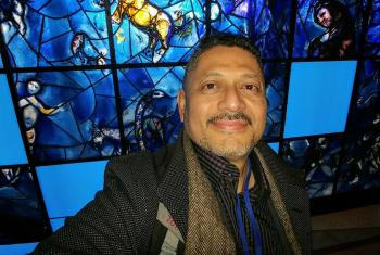 The people that walked in darkness have seen a great light: Larry Madrigal stands in front of the stained glass mural that inspired his mother at the 1994 CSW. Photo: L Madrigal