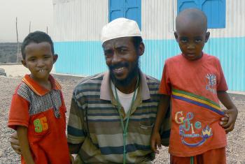 Ahmed with his children in Ali Addeh camp. The family had to flee violence for the safety of the camp in Djibouti. Photo: ALWS/Jonathan Krause