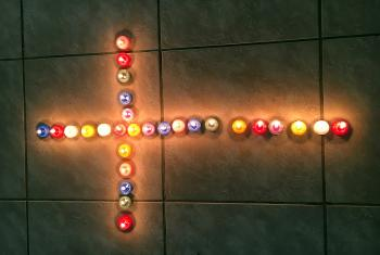 Candles lit in the shape of a cross to symbolize young adults as light in the world. Photo: LWF/C. Bader
