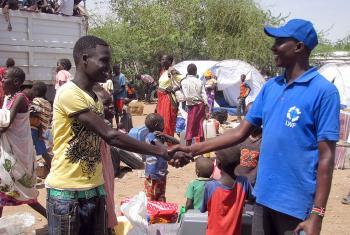 LWF staff member John Ekamais, right, with one of the new arrivals at the Kakuma reception center. Photo: LWF/James Macharia