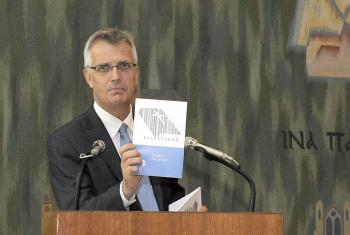 At the LWF Council 2015 meeting, General Secretary Rev. Dr Martin Junge introduces the series of booklets, Liberated by God's Grace. Photo: LWF/Helen Putsman""
