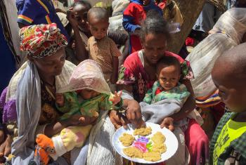 """People taste the pancakes made in a cooking distribution with the enriched """"Famix"""" flour, distributed to displaced people in Tigray. All photos: LWF/ S. Gebreyes"""