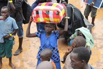 A child arrives arrives at the Elegu collection point on the South Sudan-Uganda border with what she can carry. Photo: LWF/P. Kikomeko