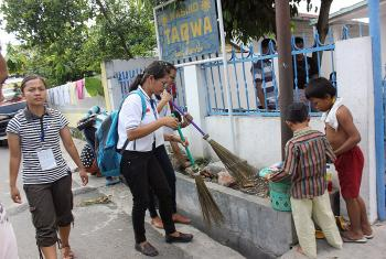 Camp participants clean a mosque. Photo: Rev. Bintahan Harianja/HKBP
