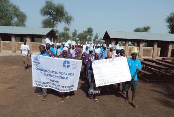 Dozens of school children march into Blue Nile Primary School protesting child marriage. Photo: LWF/J. Tiboa