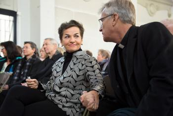 Christiana Figueres, Executive Secretary of the United Nations Framework Convention on Climate Change (UNFCCC), greets LWF Secretary General Martin Junge before a ceremony for the presentation of some 1.8 million signatures on an interfaith petition for climate justice during the COP21 climate summit in Paris, France, November 28, 2015. Photo: LWF/Ryan Rodrick Beiler