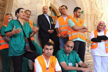 Dina Khoury, OR and infection Control Nurse, and others who were part of the AVH team sent to Gaza in August 2014, shared their experiences with an assembly of AVH staff upon the team's return to Jerusalem. Photo: LWF Jerusalem