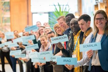 World Service staff attending the GLTM hold the names of the countries where they are working. Photo:LWF/A. Hillert