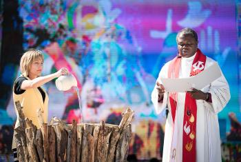 14 May 2017, Windhoek, Namibia: As Christina Jackson-Skelton, United States, pours water into the font as the words of Thanksgiving for baptism were spoken by Bishop Alex Malasusa, Tanzania. Photo: LWF/Albin Hillert