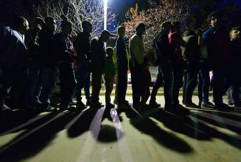 Refugees queue at Chios, Greece. Photo: Paul Jeffrey