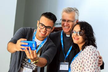 LWF General Secretary Rev. Dr Martin with LWF Youth Pre-Assembly delegates, Grosvyn Ariel Rodríguez Ramírez (Honduras), left, and Karla Steilmann (Argentina) in Ondangwa, Namibia. Photo: LWF/JC Valeriano