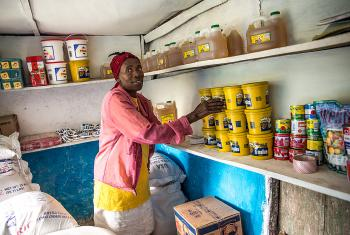 A woman in the community store in Despagne. Photo: LWF Haiti/H. Enge