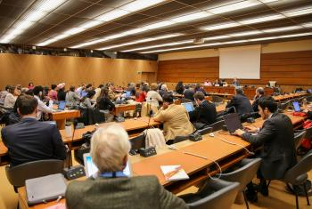 """Attendees at a side event at the United Nations in Geneva on using the Universal Periodic Review as an instrument for peace building rooted in human rights in Colombia. Photo: Peter Kenny"""""""