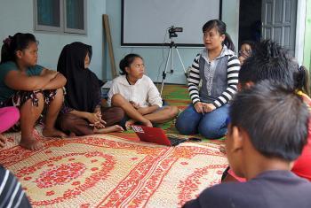 Elisabeth Purba (center) explaining about HIV/AIDS in Desa Bulu Cina, Sumatra, Indonesia. Photo: LWF/C. Kästner