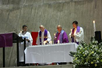 Prof. H. Augustine Suzuki (second left) lights a candle at St Mary's Cathedral in Tokyo, where Anglicans, Catholics and Lutherans held the first joint worship service. Photo: JELC