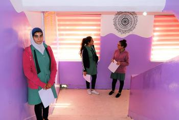 Colorful paint and student art line the hallway.jpg Caption: Proud students in the hallway of the newly renovated school. Photo: LWF/ E.Massell