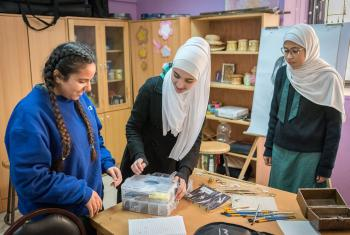 15-year-old Rena Almaharmeh (left), and her friends Danya (centre) and Asma (right) work in the Talent Room of Rufaida Al Aslamieh Primary Mixed School in Amman. All photos: LWF/Albin Hillert