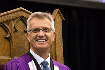 LWF General Secretary Rev. Dr Martin Junge smiles during the afternoon convocation ceremony at Wilfrid Laurier University in Waterloo, Ontario, Canada, during which he received an Honorary Doctor of Divinity degree. Photo: Waterloo Lutheran Seminary