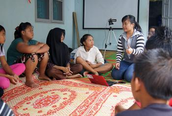 Elisabeth Purba (center) talking about HIV and AIDS at a youth workshop organized by the Indonesia LWF National Committee in Desa Bulu Cina, Sumatra. New global development goals will work to lower HIV and AIDS transmission rates. Photo: LWF/C. Kästner