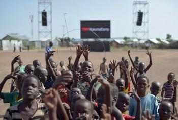 Children hold up an antenna to better receive the TEDx broadcast in Kakuma refugee camp. All photos: TEDx