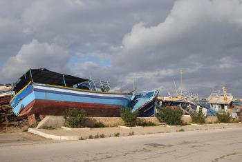 Vessels used to transport migrants across the Mediterranean Sea lie rotting and decayed in a ships' graveyard on the Italian island of Lampedusa. Photo: CCME/Franca di Lecce