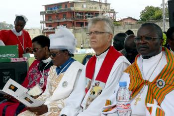 From the right: Bishop Dr Jensen Seyenkulo of the Lutheran Church in Liberia;  LWF General Secretary Rev. Dr Martin Junge; LWF Vice-President for Africa, Rev. Dr Jeannette Ada Maina, Evangelical Lutheran Church of Cameroon; and the Africa region area secretary, Rev. Dr Elieshi Mungure, during the ecumenical worship service at the Antoinette Tubman Stadium in Monrovia, Liberia. LWF/Felix  Samari