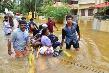 Rescue teams work to save people stranded after severe flooding in Kerala, India. Photo: Shishir Kurian/CSI
