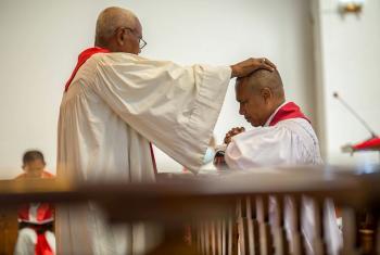 Malagasy Lutheran Church President Rev. Dr Denis Rakotozafy (kneeling) was installed during Sunday worship in Antananarivo, Madagascar. Photo: MLC