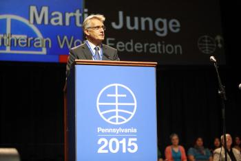 Rev. Dr Martin Junge addresses the Mennonite World Conference, saying the forgiveness of Mennonites brought Lutherans and Mennonites closer together to serve the world. Photo: Jon Carlson for Mennonite World Conference