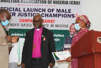 Rev. Dr. Gibson Ezekiel Lesmore (left), AACC director for Peace, Diakonia and Development, presents the Patron of Gender Justice Champion in Africa award to LWF President Archbishop Dr. Panti Filibus Musa. On the right is Ms Rhoda Ezekiel. Photo: ALCINET/Felix Samari