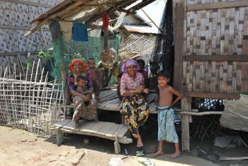 A family in Nget Chaung-2 IDP camp in Pauk Taw, Myanmar. Photo: LWF/ C. Kästner