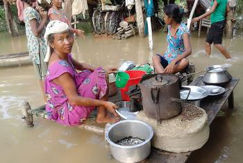 A woman from Bhajani Municipality, in Kailali district in the far western part of Nepal cooks food at waterlogged premises. Photos: LWF/ P. Maharjan