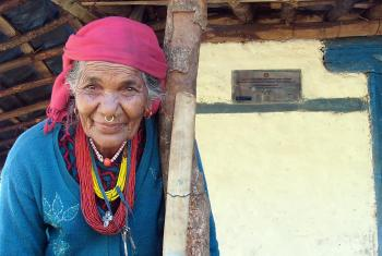 "Kali Kamini, known as ""grandma"" to the village, in front of her new house. Photo: LWF/ U. Pokharel"