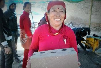 Kabita Shrestha's friend Kanchhi Shrestha carrying an unfired brick. Photo: LWF/Lucia de Vries