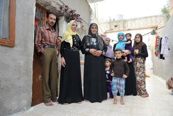 A Syrian family living in an unfinished building in Al Mafraq. Many refugees have to trade their food vouchers to pay the rent. Photo: LWF/ M. Renaux