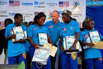 Jesse Kamstra, LWF country representative in Uganda (center), with the winners of the contest. Photos: LWF/ S. Nalubega