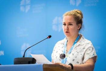 Ms Vera Tkach, chairperson of the Ad-hoc Committee for Advocacy and Public Voice, presents the resolution on Nigeria to the LWF council. Photo: LWF/ Albin Hillert