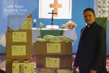 The Lutheran Church in Grodno, Belarus, Rev. Vladimir Tatarnikov stands with supplies purchased with LWF COVID-19 Rapid Response Funds. Photo: The Lutheran Church in Grodno