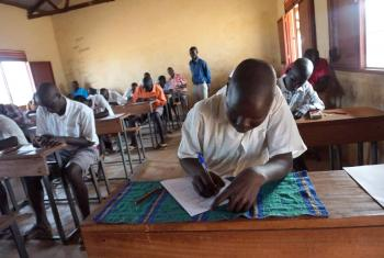 Primary school students sit their final examination at Napata school in Ajoung Thok refugee camp, South Sudan. Photo: LWF South Sudan