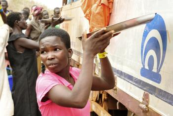 South Sudanese refugees receive a hot meal at Palorinya refugee camp, Uganda. Photo: LWF/ C. Kästner