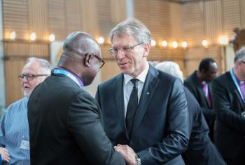 LWF President Musa and WCC General Secretary Tveit meeting at the LWF Council 2018 in Geneva. Photo: LWF/Albin Hillert