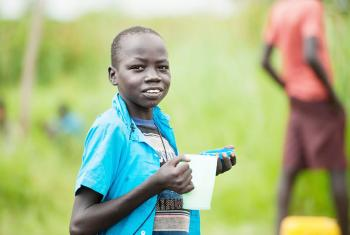 A young South Sudanese refugee eats porridge in Northern Uganda. Photos:LWF/Uganda