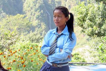 Sanu in her school uniform. The prospect of higher education prompted her to find a way of attending school, even though school is a day's walk from home. Photo: Umesh Pokharel/LWF Nepal