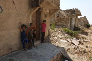 Children play in the destroyed suburbs in Aleppo. Photo: LWF/ R. Schlott