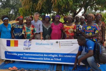 LWF's Josef Pfattner stands with a group working on strengthening resilience and self-sufficiency for women in Chad. Photo: LWF/Chad
