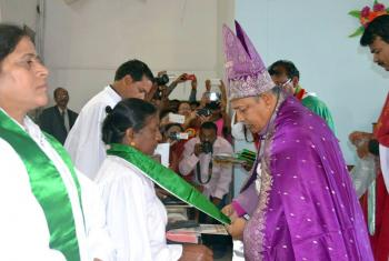 Bishop Emmanuel Panchoo declares Rev. Elizabeth Prasad an ordained pastor of the Madhya Pradesh Lutheran church, one of the first women to be ordained in the church. In the foreground, Rev. L.K. Khakha, another of the four women to be ordained by the church for the first time. Photo: ELC-MP/Nima David