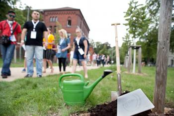 Symbolic tree planting in the Luthergarten in Wittenberg, Germany, during the global young reformers meeting, Workshop Wittenberg, in 2015. Photo: LWF/Marko Schoeneberg