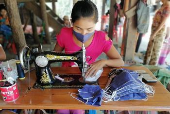 A woman entrepreneur sews cloth face masks in Sittwe, Rakhine State, Myanmar. Photo: LWF/Nu Nu Aye