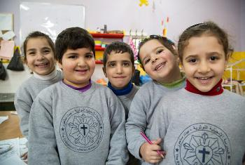 Students from the kindergarten of the Evangelical Lutheran School in Beit Sahour take a break from learning their Arabic alphabet to pose for a photo. Photo: ELCJHL