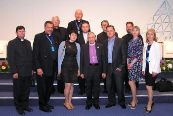 LWF President Bishop Dr Munib A. Younan with Bishop Yuri Novgorodov (very last row) and other pastors and church officials of the Evangelical Lutheran Church in the Republic of Kazakhstan, during the June visit to Astana. Photo: ELCRK
